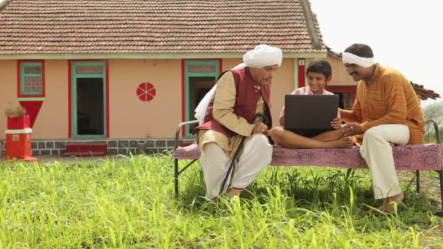 boy teaching laptop to his father and grandfather  - turban stock videos & royalty-free footage