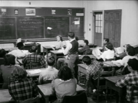 B/W 1951 REAR VIEW boy throwing paper airplane in classroom / educational