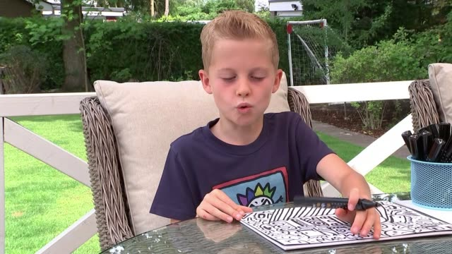boy told not to doodle at school lands book deal england shrewsbury ext joe whale interview sot - drawing activity stock videos & royalty-free footage