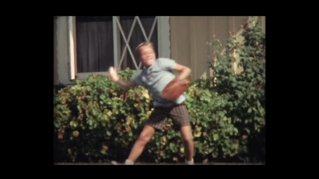1966 boy tosses ball while friend films him - bonding stock videos & royalty-free footage
