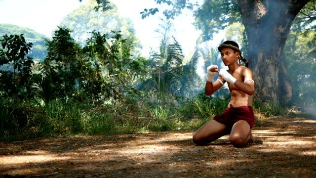 a boy training muay thai - muay thai stock videos and b-roll footage