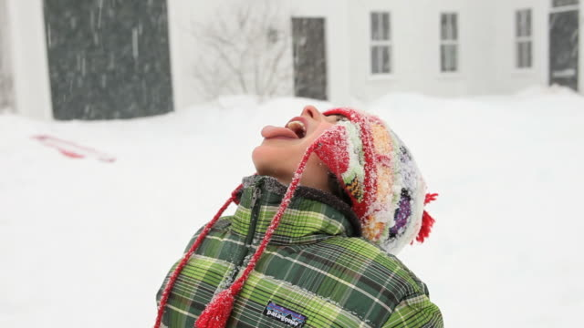 cu boy trying to catch snowflakes on his tongue / yarmouth, maine, usa - snowflake stock videos & royalty-free footage