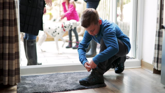 boy tying shoe laces - dog walker stock videos and b-roll footage
