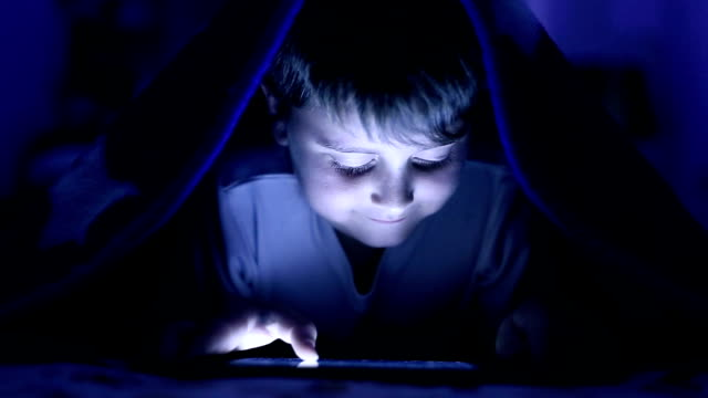 boy under cover using tablet - sheet stock videos & royalty-free footage