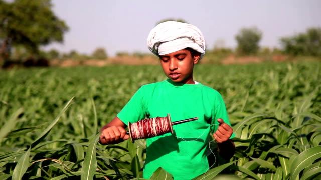 Boy unfolding thread