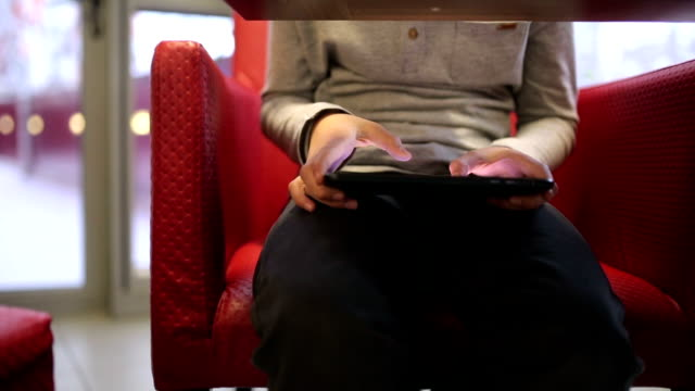 boy uses the digital tablet under the table - table stock videos and b-roll footage