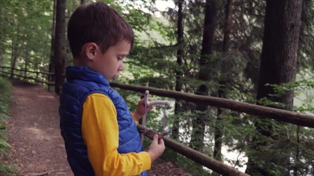 Boy using a slingshot toy