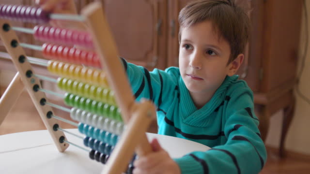Boy using abacus, slow motion