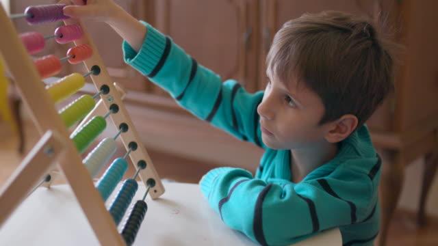 Boy using abacus