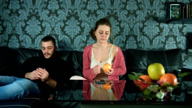 stockvideo's en b-roll-footage met jongen met behulp zijn slimme telefoon en niet aandacht te besteden aan een meisje - communication problems