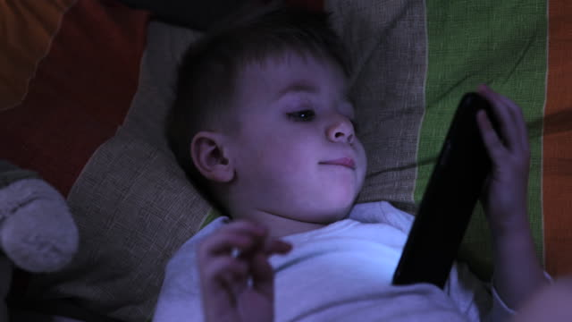 boy using phone at night - bedtime stock videos & royalty-free footage