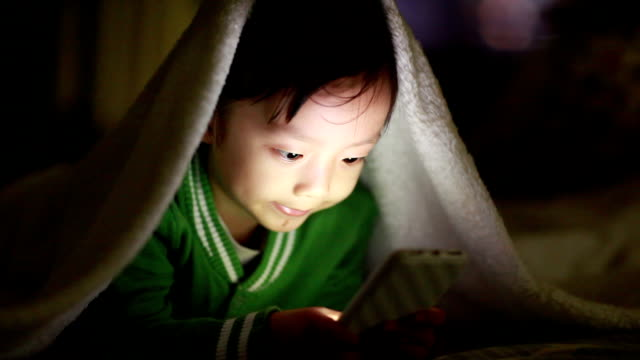boy using smart phone - duvet stock videos & royalty-free footage