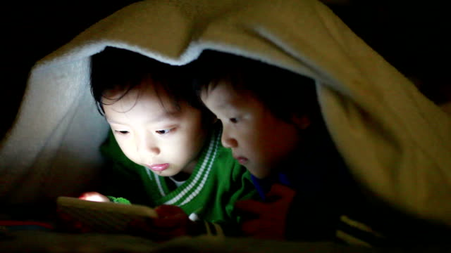 boy using smart phone - toy stock videos & royalty-free footage