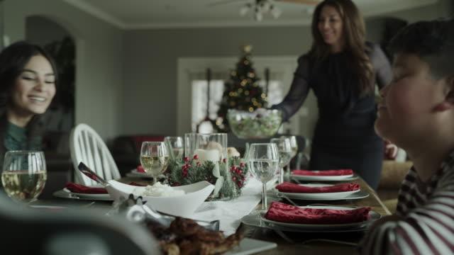 boy waiting as family arrives at table for christmas dinner / orem, utah, united states - orem utah stock videos & royalty-free footage