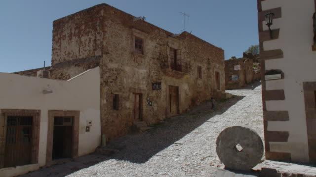 WS Boy walking on old cobblestone street / Real de Catorce, San Luis Potosi, Mexico