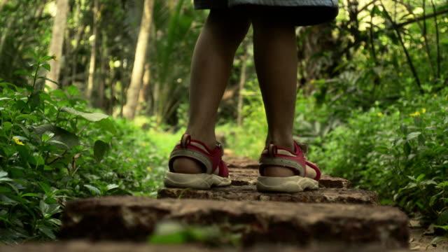 boy walking on stone blocks - eternity stock videos & royalty-free footage