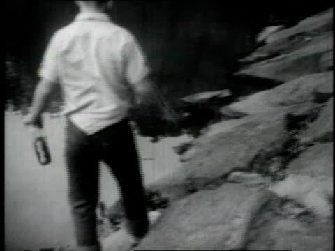 vídeos y material grabado en eventos de stock de montage boy walking through the park, sound of boy singing about oreos, eating oreos out of the bag lying against a tree - 1970