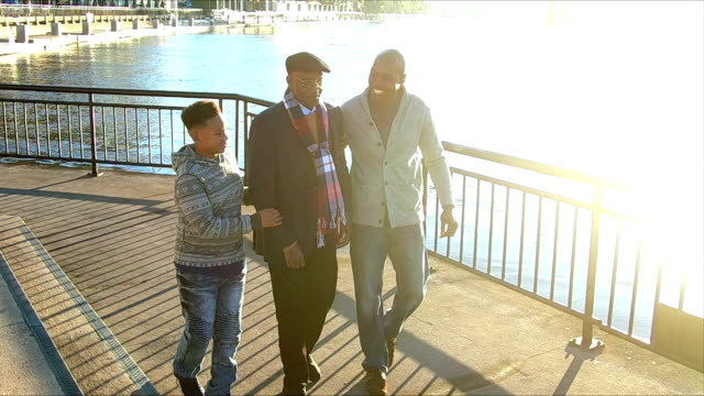 boy walking with father and great grandfather - pullover stock videos & royalty-free footage