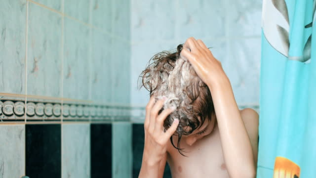 boy washes his head in the bathroom - shampoo stock videos & royalty-free footage