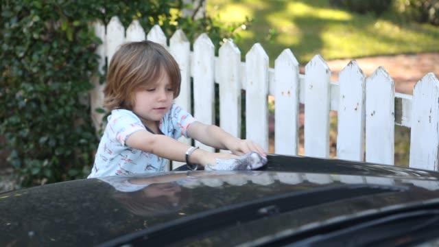boy washing car - rag stock videos & royalty-free footage
