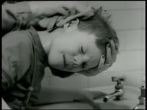 dramatization boy washing face at sink mother checking back of his ears mother scrubbing w/ wash cloth boy putting on coat going out to play digging... - scolding stock videos & royalty-free footage