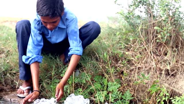 boy washing hand & feet in flowing water - hygiene stock videos & royalty-free footage