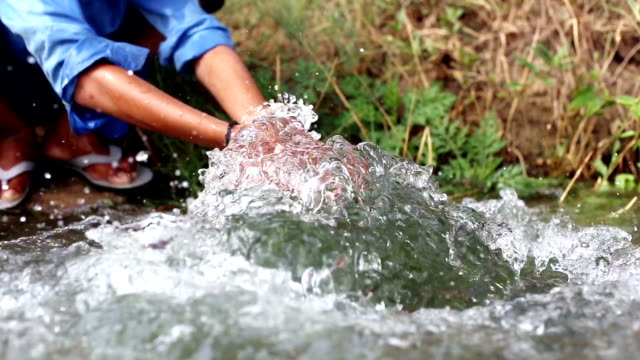 boy washing hand & feet in flowing water - hamlet play stock videos and b-roll footage