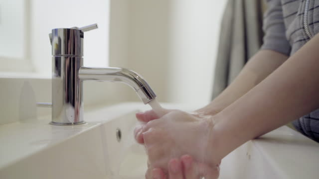 boy washing hands - bathroom sink stock videos & royalty-free footage