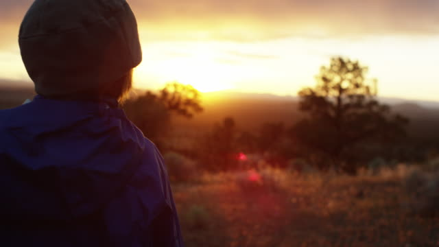ots boy watches sunset after hiking - woolly hat stock videos and b-roll footage