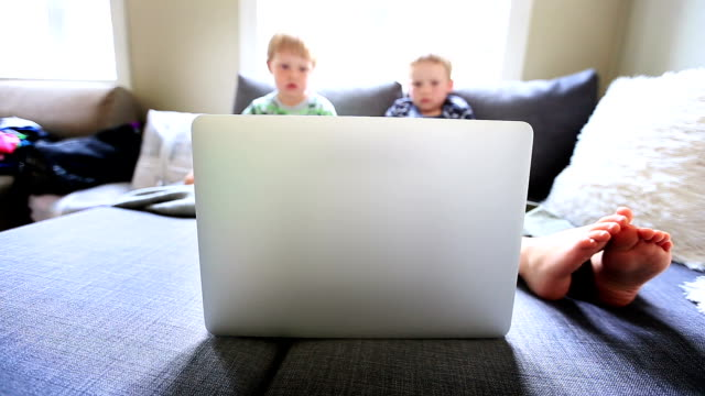 boy watching cartoons on laptop