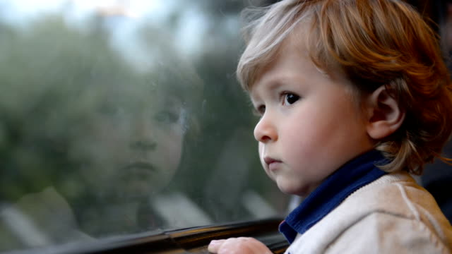 Boy watching out of the train