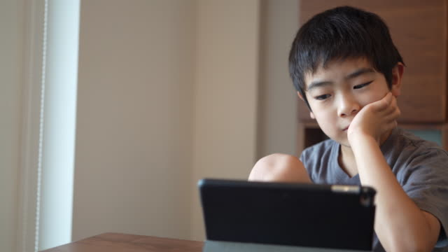 boy watching tablet - childhood stock videos & royalty-free footage
