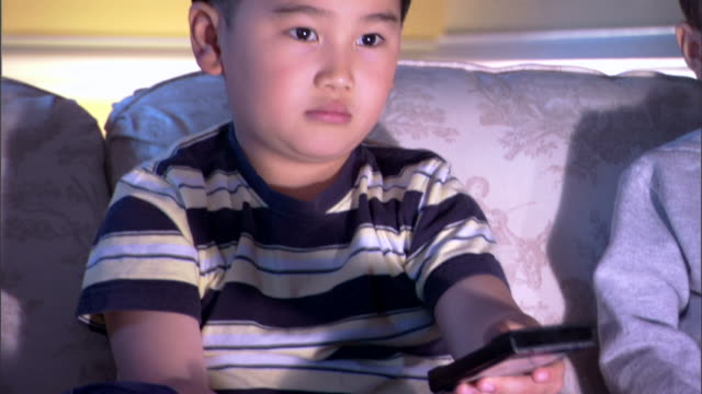 boy watching television - east asian ethnicity stock videos & royalty-free footage