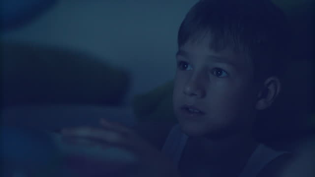 a boy watching tv in the evening - teenage boys stock videos & royalty-free footage