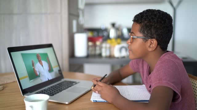boy watching video class at home - junior high stock videos & royalty-free footage