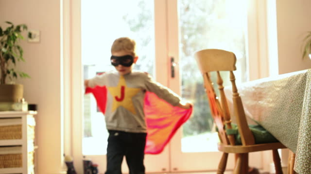 boy wearing cape and eye mask  - imagination stock videos and b-roll footage
