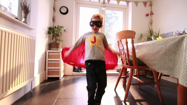 boy wearing cape and eye mask  - mischief stock videos & royalty-free footage