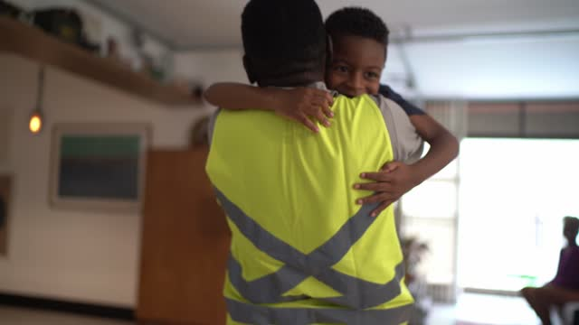 boy welcoming and embracing grandfather when he's arriving at home - primary age child stock videos & royalty-free footage