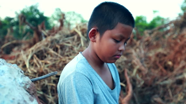boy who suffer from natural disasters with a sad face, slow motion - demolished stock videos & royalty-free footage