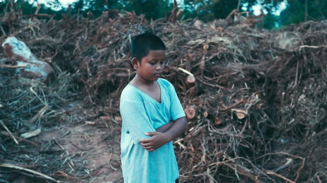 boy who suffer from natural disasters with a sad face, slow motion - emergencies and disasters stock videos & royalty-free footage