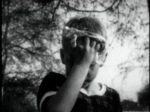 b/w cu boy wiping forehead with towel / usa - forehead stock videos and b-roll footage