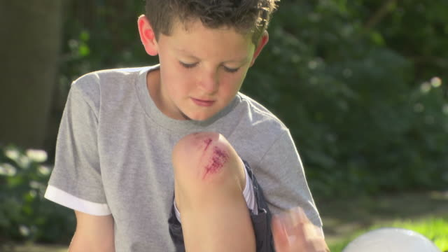 boy with a grazed knee - wounded stock videos & royalty-free footage