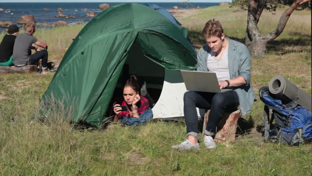 boy with a laptop in nature - tent stock videos & royalty-free footage