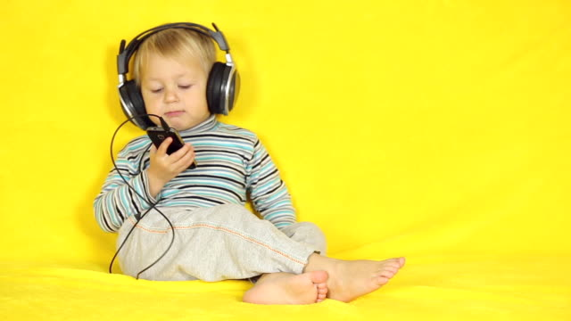 boy with a smartphone - listening stock videos & royalty-free footage