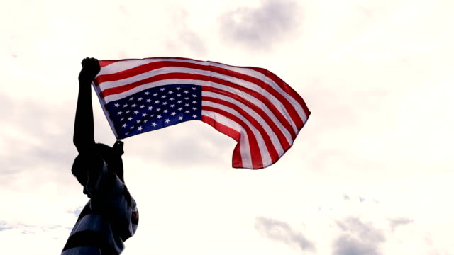 4k ms: boy with american flags - flag stock videos & royalty-free footage