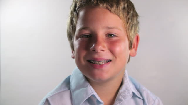 boy with braces - brace stock videos and b-roll footage