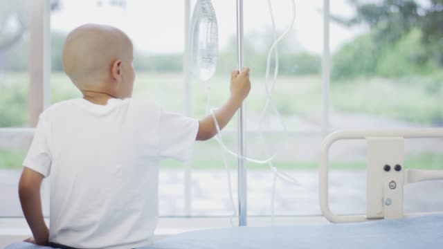 boy with cancer holding an iv drip - one boy only stock videos & royalty-free footage