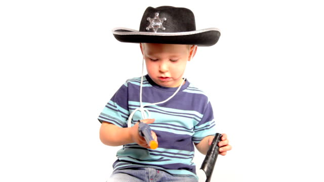 boy with cowboy hat and gun - toy gun stock videos & royalty-free footage