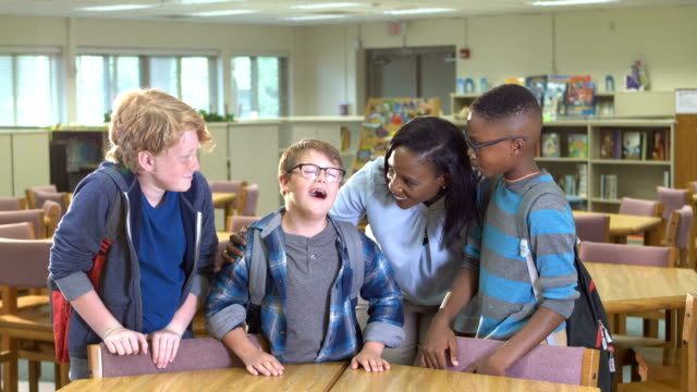 boy with down syndrome, students, teacher at school - 10 11 years stock videos and b-roll footage