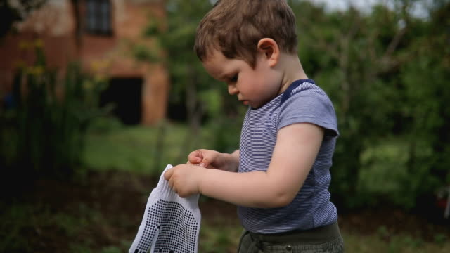 boy with gardening gloves